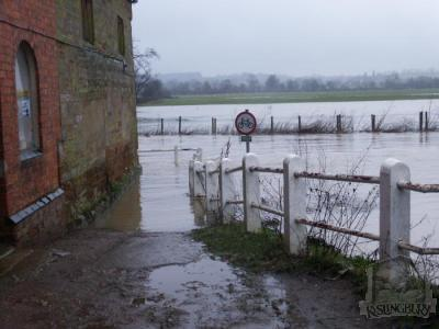 The river Nene in flood at the corner of The Mill [138]